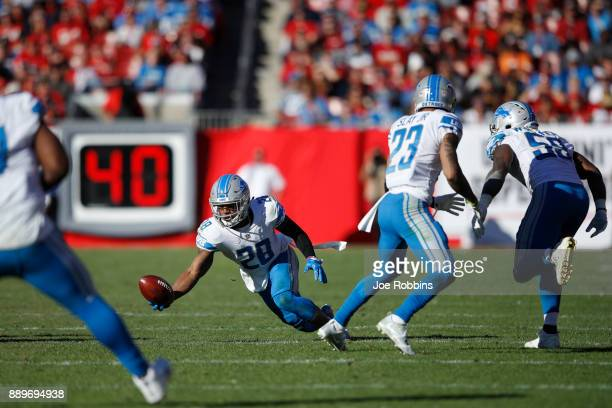 Quandre Diggs of the Detroit Lions tries to make a onehanded interception against the Tampa Bay Buccaneers in the third quarter of a game at Raymond...