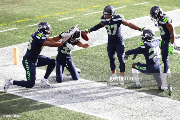 Quandre Diggs of the Seattle Seahawks celebrates his interception against the New York Giants during the first quarter in the game at Lumen Field on...