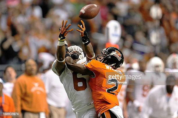 Quandre Diggs of the University of Texas Longhorns is unable to intercept a pass intended for Markus Wheaton of the Oregon State Beavers during the...