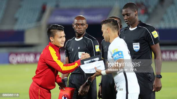 Quang Hai Nguyen of Vietnam and Clayton Lewis of New Zealand shake hands before the FIFA U20 World Cup Korea Republic 2017 group E match between...