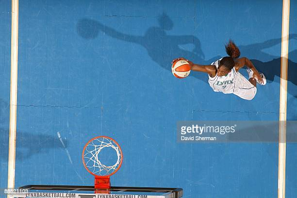 Quanitra Hollingsworth of the Minnesota Lynx rebounds the ball during the WNBA game against the Seattle Storm on June 12 2009 at Target Center in...