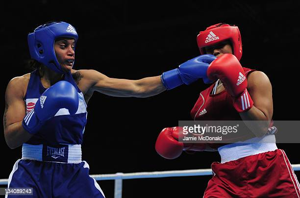 Quanitta Underwood of USA punches Natasha Jonas of Great Britain during their quaterfinal 57kg60kg bout at ExCel on November 25 2011 in London England