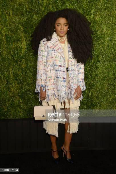 Quann wears a multicolored fantasy tweed jacket from the CHANEL SpringSummer 2018 Act 2 Readyto Wear Collection with CHANEL Shoes Bag and Accessories...