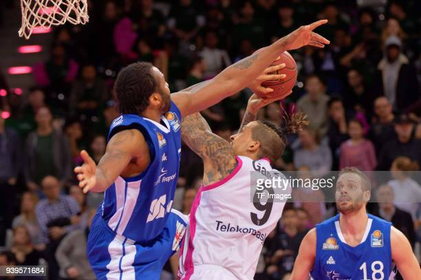 Quantez Robertson of Bonn and Julian Gamble of Bonn battle for the ball during the Basketball Bundesliga match between Telekom Baskets Bonn and...
