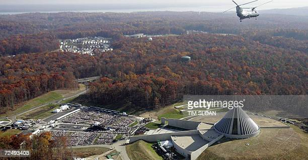 As a Marine helicopter flies over hundreds of invited guest await the arrival of US President George W Bush for the dedication of the National Museum...