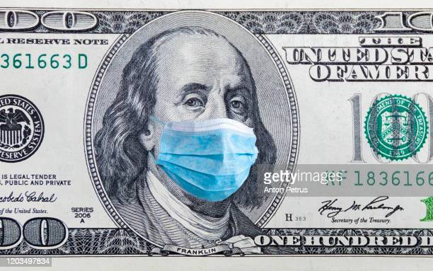 us quarantine, 100 dollar banknote with medical mask. the concept of epidemic and protection against coronavrius. - geld stock-fotos und bilder