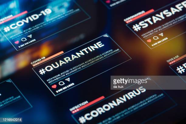 #quarantine hashtag for social networks close-up on digital display - covid icons stock pictures, royalty-free photos & images