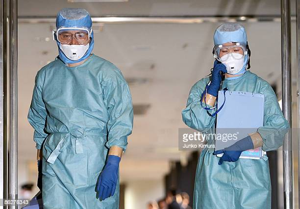 Quarantine officers come out from an airplane arriving from Mexico via the US at Narita International Airport on April 29 2009 in Narita Japan Swine...