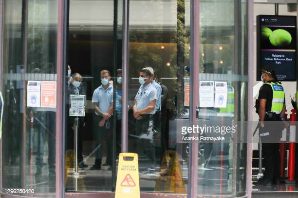 Quarantine Staff and protective service officers wearing a mask are seen in the lobby of The Pullman Hotel in Albert Park which is one of the three...