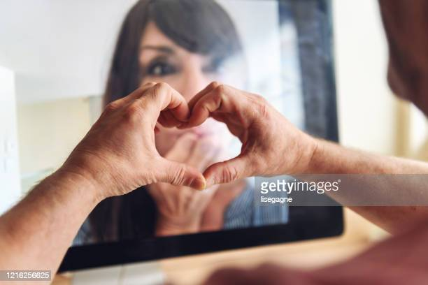 quarantined couple doing a video call - stay at home order stock pictures, royalty-free photos & images