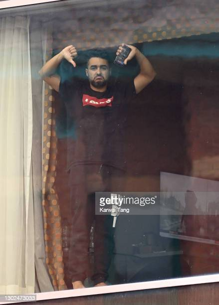 Quarantining passenger shows his frustration at having to isolate for 10 days at the Radisson Blu hotel on February 16, 2021 in London, England. From...