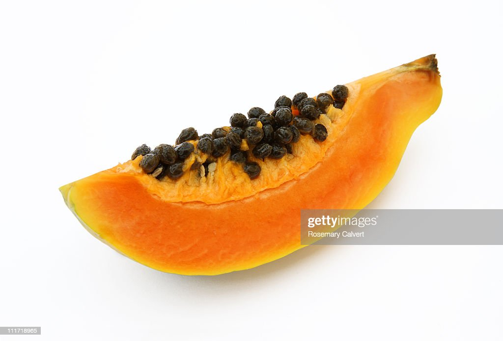 Quarater of a fresh, ripe papaya or paw paw. : Stock Photo