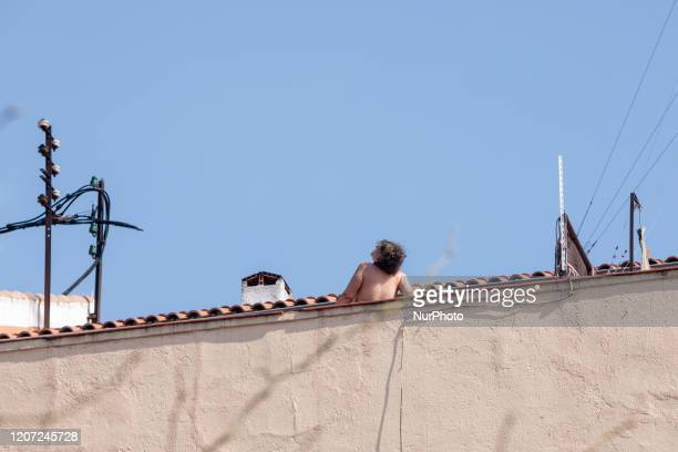 Quarentined woman due to Covid19 sunbathes from rooftop on March 15 2020 in Madrid Spain The cases in Madrid are reportedly at least 2807 people...
