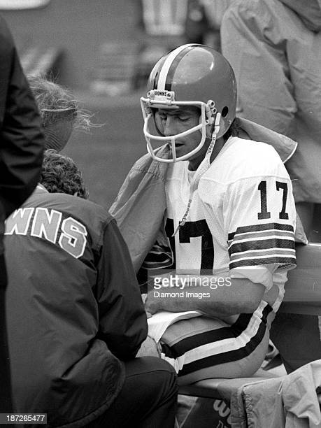 Quarerback Brian Sipe of the Cleveland Browns is attended to by trainers on the sideline during a game against the New York Jets on October 9 1983 at...