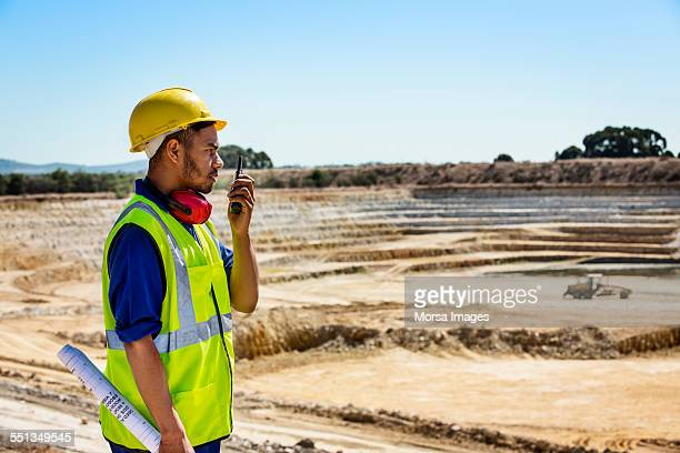 Quarry worker using walkie-talkie at site