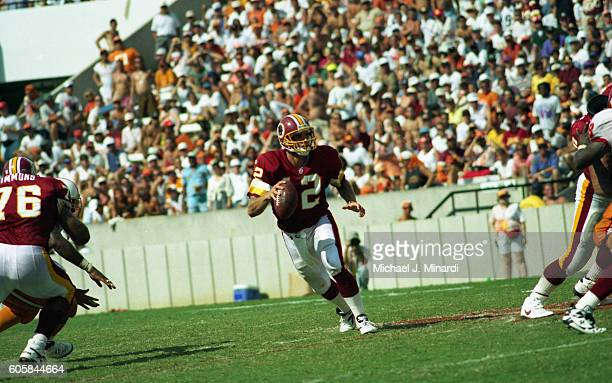 Quarter Back Gus Frerotte of the Washington Redskins runs out of the pocket looking for a receiver in a NFL football game against the Tampa Bay...