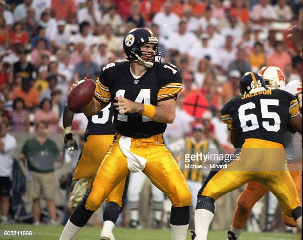 Quarter Back Neil O'Donnell of the Pittsburgh Steelers drops back in the pocket and looks for a pass receiver in a NFL football game against the...
