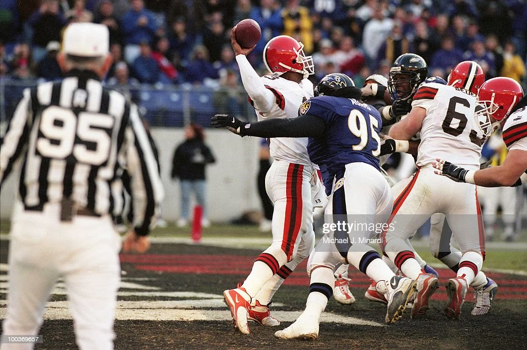 Quarter back Spergon Wynn #13 of the Cleveland Browns passed just as he was sacked by Defensive Tackle Sam Adams #95 of the Baltimore Ravens at PSINet Ravens Stadium on November 26, 2000 in Baltimore, Maryland. The Ravens won 44 to 7.