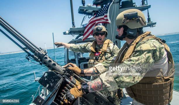 Quarter Master 2nd Class Patrick Riley speaking to Quarter Master Seaman Kolton Kelly during a simulated small boat attack exercise San Diego May 10...