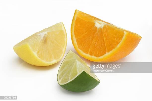 Quarter of orange, lemon and lime.