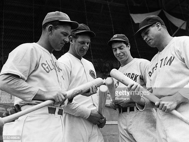 A quarter of sluggers than which there is no whicher is shown comparing cudgels at the AllStar game Left to right Mel Ott of the New York Giants...