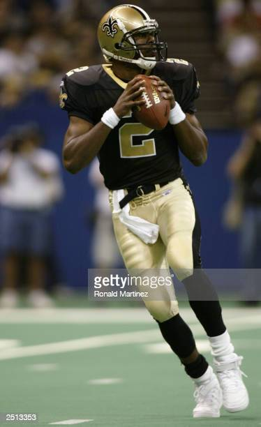 Quarterback Aaron Brooks of the New Orleans Saints drops back to pass against the Houston Texans during the game at the Louisiana Superdome on...