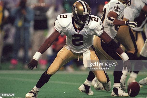 Quarterback Aaron Brooks of the New Orleans Saints fumbles a snap against the Minnesota Vikings in the 2000 NFC Divisional Playoff Game at the...