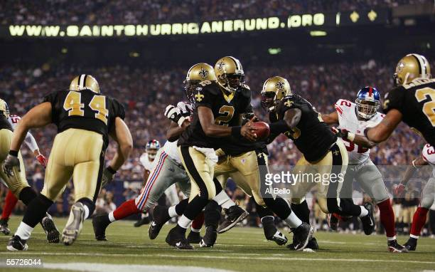 Quarterback Aaron Brooks of the New Orleans Saints looks to hand the football off against the New York Giants in the second quarter September 19,...