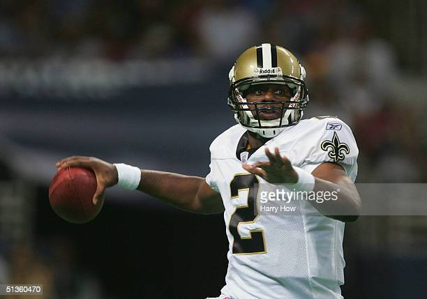 Quarterback Aaron Brooks of the New Orleans Saints looks to pass against the St. Louis Rams during the third quarter at the Edward Jones Dome on...
