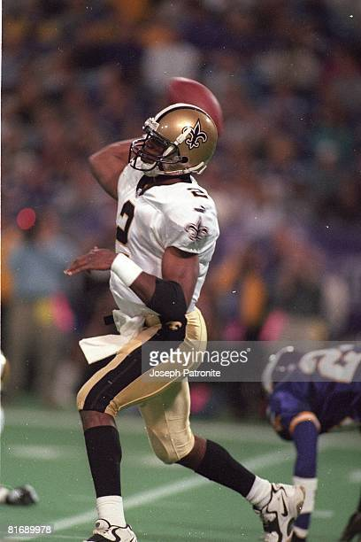 Quarterback Aaron Brooks of the New Orleans Saints throws a pass against the Minnesota Vikings in the 2000 NFC Divisional Playoff Game at the...