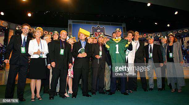 Quarterback Aaron Rodgers drafted 24th overall by the Green Bay Packers poses with family and friends during the 70th NFL Draft on April 23 2005 at...