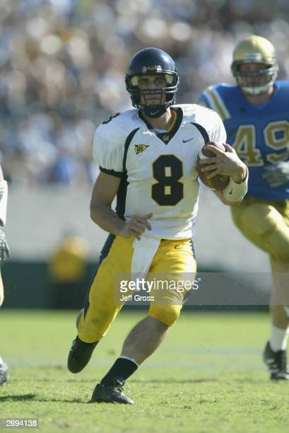 Quarterback Aaron Rodgers of the California Golden Bears runs the football in the game against the UCLA Bruins on October 18, 2003 at the Rose Bowl...