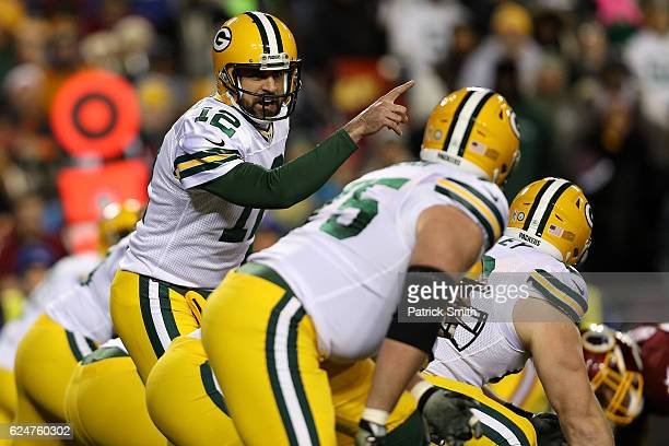 Quarterback Aaron Rodgers of the Green Bay Packers calls from the line of scrimmage against the Washington Redskins in the first quarter at...