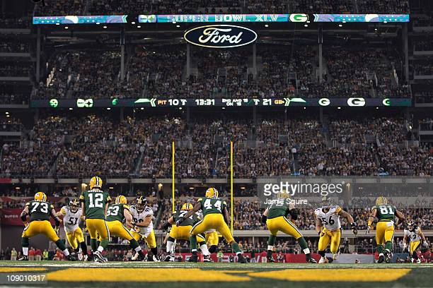 Quarterback Aaron Rodgers of the Green Bay Packers calls signals out of the shotgun formation against James Farrior Casey Hampton LaMarr Woodley and...