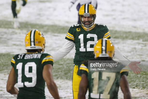Quarterback Aaron Rodgers of the Green Bay Packers celebrates a touchdown pass to Equanimeous St. Brown against the Tennessee Titans during the...