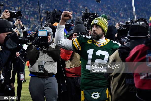Quarterback Aaron Rodgers of the Green Bay Packers celebrates after their 28-23 win over the Seattle Seahawks in the NFC Divisional Playoff game at...