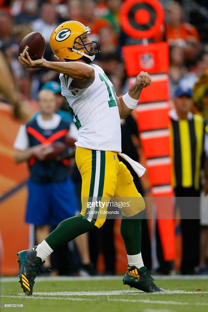 Quarterback Aaron Rodgers #12 of the Green Bay Packers completes a pass in the first quarter during a Preseason game against the Denver Broncos at Sports Authority Field at Mile High on August 26, 2017 in Denver, Colorado.