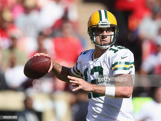 Quarterback Aaron Rodgers of the Green Bay Packers drops back to pass against the San Francisco 49ers in the first half at Candlestick Park on...