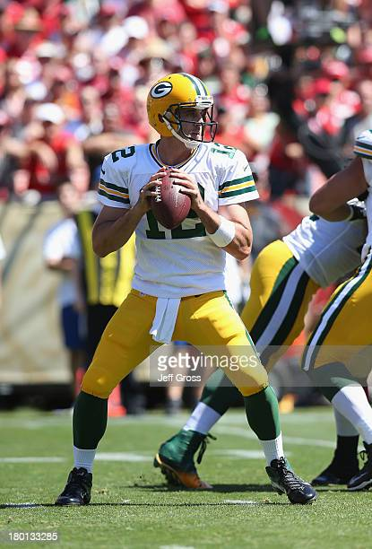 Quarterback Aaron Rodgers of the Green Bay Packers drops back to pass against the San Francisco 49ers at Candlestick Park on September 8 2013 in San...