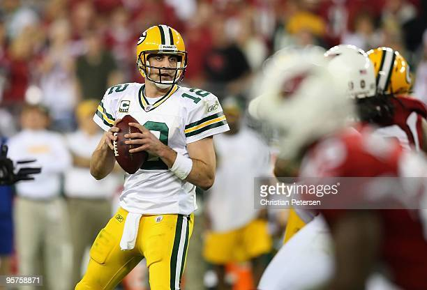 Quarterback Aaron Rodgers of the Green Bay Packers drops back to pass during the 2010 NFC wildcard playoff game against the Arizona Cardinals at the...
