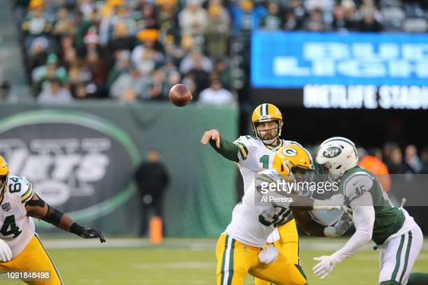 Quarterback Aaron Rodgers of the Green Bay Packers in action against the New York Jets at MetLife Stadium on December 23 2018 in East Rutherford New...