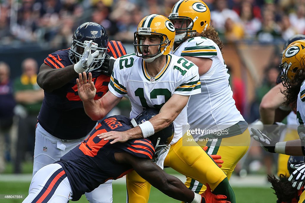 Quarterback Aaron Rodgers #12 of the Green Bay Packers is hit by Christian Jones #59 of the Chicago Bears in the first quarter at Soldier Field on September 13, 2015 in Chicago, Illinois.