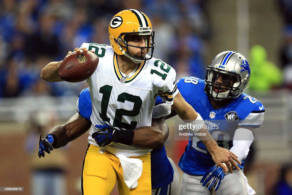 Quarterback Aaron Rodgers #12 of the Green Bay Packers is sacked by middle linebacker Stephen Tulloch #55 and cornerback Quandre Diggs #28 of the Detroit Lions in the first half at Ford Field on December 3, 2015 in Detroit, Michigan.