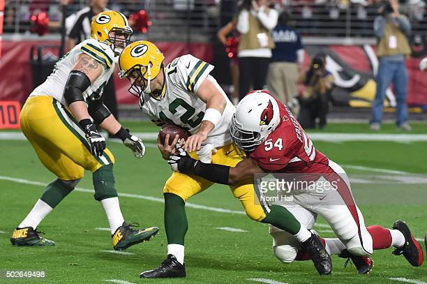Quarterback Aaron Rodgers of the Green Bay Packers is sacked by inside linebacker Dwight Freeney of the Arizona Cardinals in the third quarter of the...