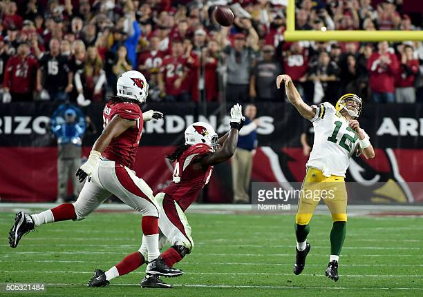 Quarterback Aaron Rodgers of the Green Bay Packers launches a pass at the end of regulation in the NFC Divisional Playoff Game at University of...