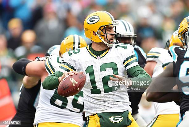 Quarterback Aaron Rodgers of the Green Bay Packers looks for a receiver during a NFL game against the Carolina Panthers at Bank Of America Stadium on...