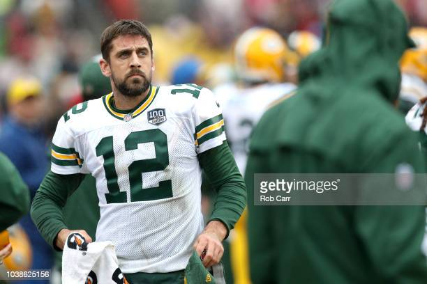 Quarterback Aaron Rodgers of the Green Bay Packers looks on from the sidelines in the second half against the Washington Redskins at FedExField on...