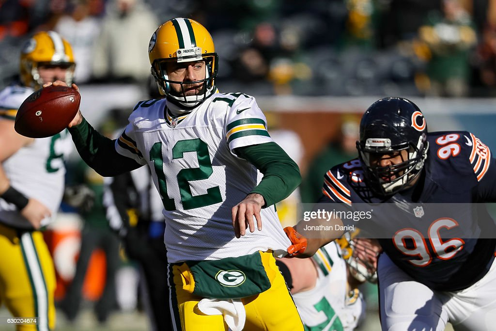 Quarterback Aaron Rodgers #12 of the Green Bay Packers looks to pass against Akiem Hicks #96 of the Chicago Bears in the first quarter at Soldier Field on December 18, 2016 in Chicago, Illinois.