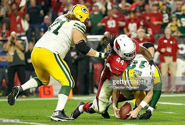 Quarterback Aaron Rodgers of the Green Bay Packers losses the ball against outside linebacker Markus Golden of the Arizona Cardinals during the final...