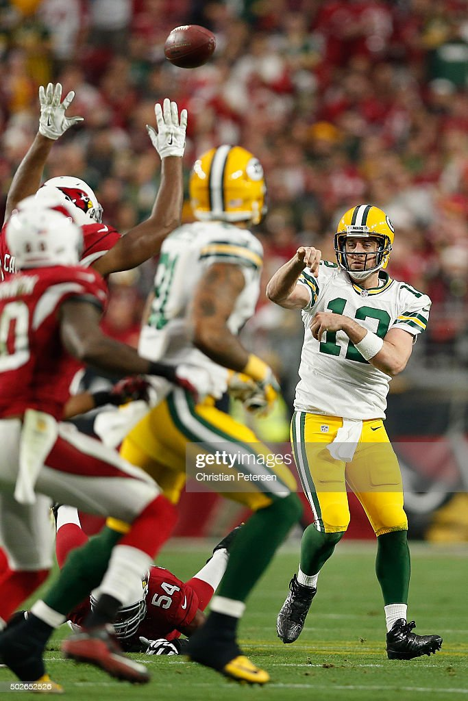 Quarterback Aaron Rodgers #12 of the Green Bay Packers makes a pass during the third quarter of the NFL game against the Arizona Cardinals at the University of Phoenix Stadium on December 27, 2015 in Glendale, Arizona. The Cardinals defeated the Packers 38-8.
